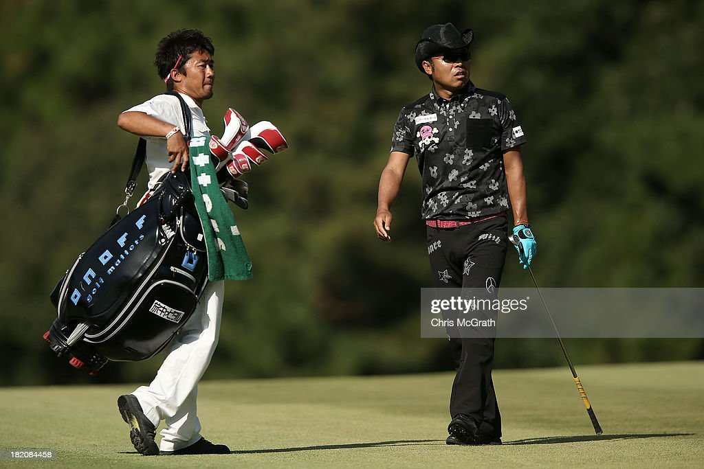 Shingo Katayama of Japan and caddie react after his second shot on the 15th hole during day three of the Panasonic Japan Open at Ibaraki Golf Club on September 28, 2013 in Ibaraki, Japan.