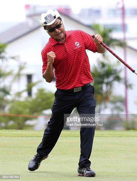 Shingo Katayama of Japan celebrates sinking a putt during day two of the EurAsia Cup presented by DRBHICOM at Glenmarie GCC on January 16 2016 in...