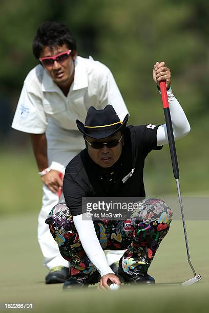 Shingo Katayama of Japan lines up his putt on the fourth hole during day four of the Panasonic Japan Open at Ibaraki Golf Club on September 29 2013...