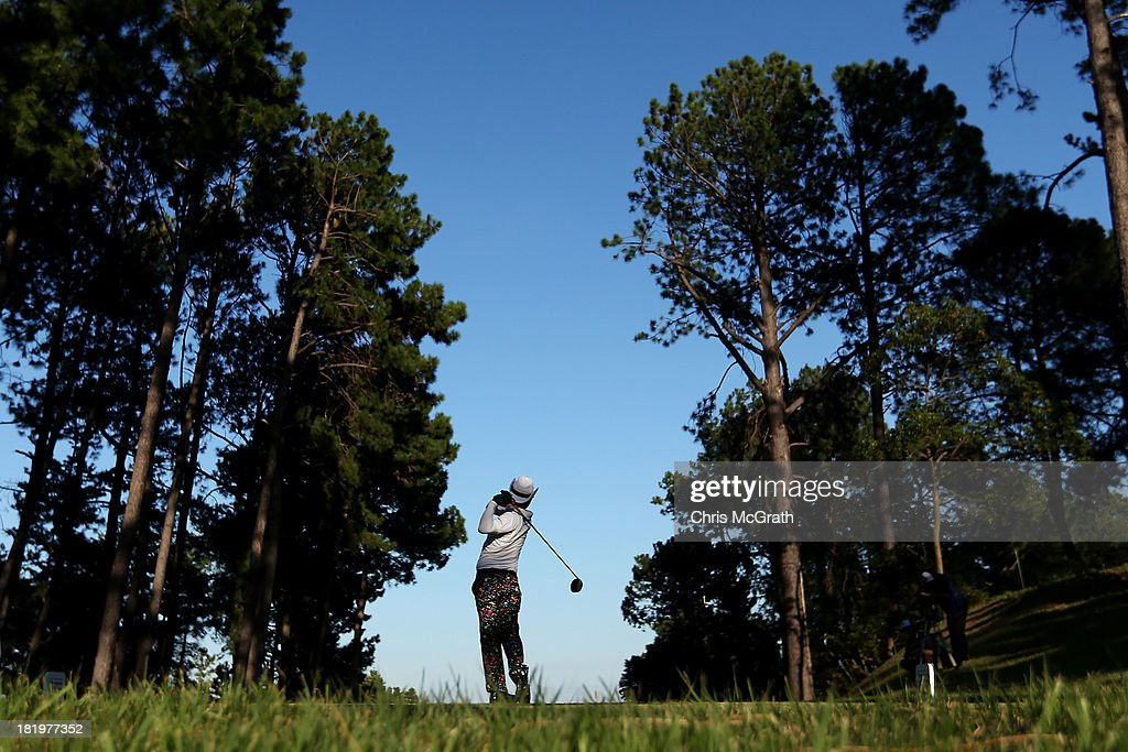 <a gi-track='captionPersonalityLinkClicked' href=/galleries/search?phrase=Shingo+Katayama&family=editorial&specificpeople=206186 ng-click='$event.stopPropagation()'>Shingo Katayama</a> of Japan plays off the eighth tee during day two of the Panasonic Japan Open at Ibaraki Golf Club on September 27, 2013 in Ibaraki, Japan.