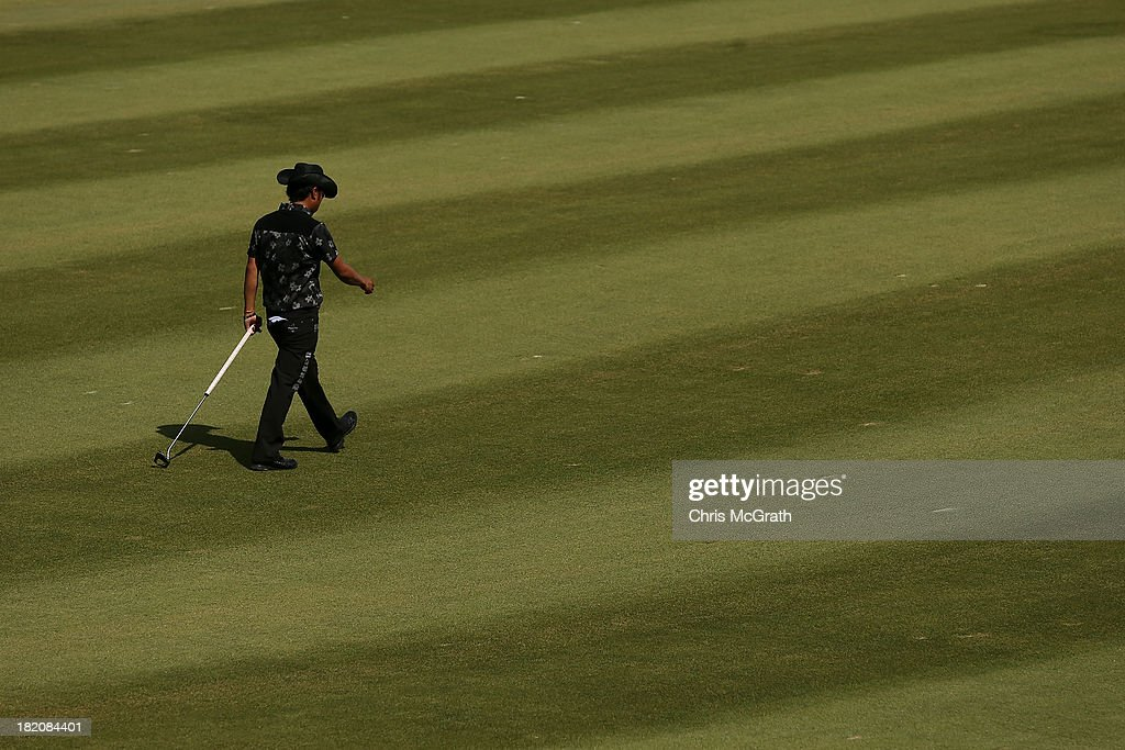 <a gi-track='captionPersonalityLinkClicked' href=/galleries/search?phrase=Shingo+Katayama&family=editorial&specificpeople=206186 ng-click='$event.stopPropagation()'>Shingo Katayama</a> of Japan walks to the ninth green during day three of the Panasonic Japan Open at Ibaraki Golf Club on September 28, 2013 in Ibaraki, Japan.