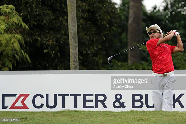 Shingo Katayama of Team Asia plays his shot on the 12th hole during the fourball match play at Glenmarie GCC on January 15 2016 in Kuala Lumpur...