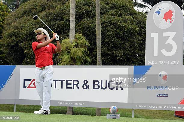 Shingo Katayama of Team Asia plays his tee shot on the 13th hole during the fourball match play at Glenmarie GCC on January 15 2016 in Kuala Lumpur...