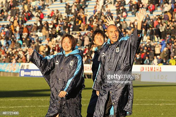 Shingo Kumabayashi Hiroshi Nanami and Naohiro Takahara wave to fans after the Daisuke Oku Memorial Match between J Amigos and Yokohama Friends at...