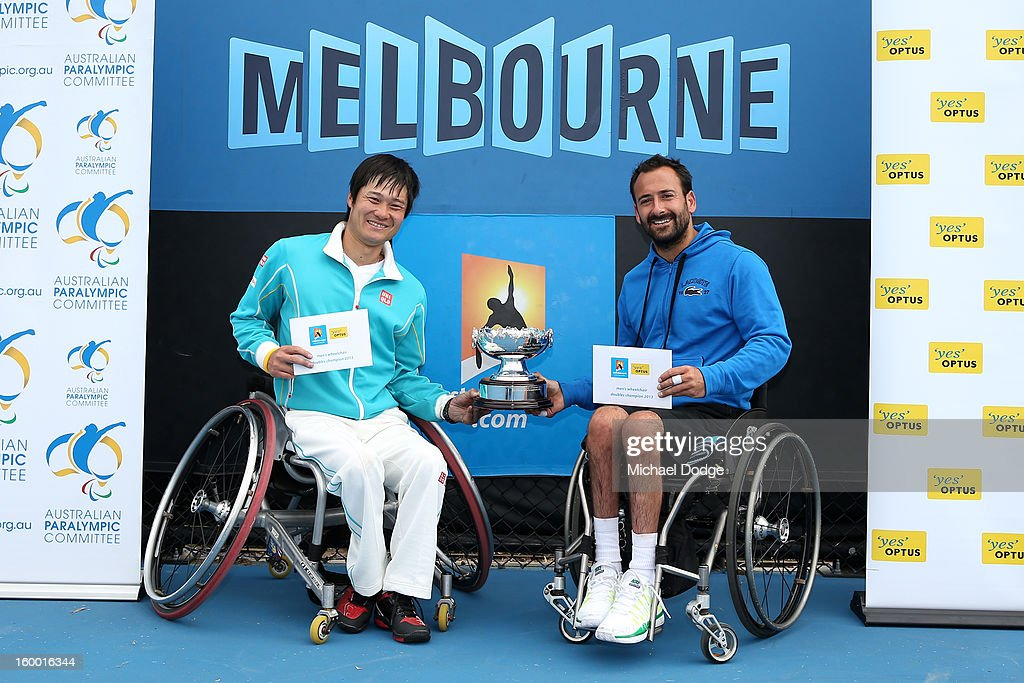 Shingo Kunieda of Japan and Michael Jeremiasz of France celebrate winning their Wheelchair Doubles Final against Adam Kellerman of Australia and Stefan Olsson of Sweden at Melbourne Park on January 25, 2013 in Melbourne, Australia.
