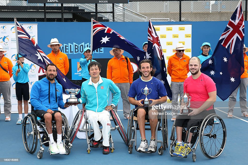 Shingo Kunieda of Japan and Michael Jeremiasz of France with the winners trophy, and Adam Kellerman of Australia and Stefan Olsson of Sweden with the runners up trophy after their Wheelchair Doubles Final against at Melbourne Park on January 25, 2013 in Melbourne, Australia.