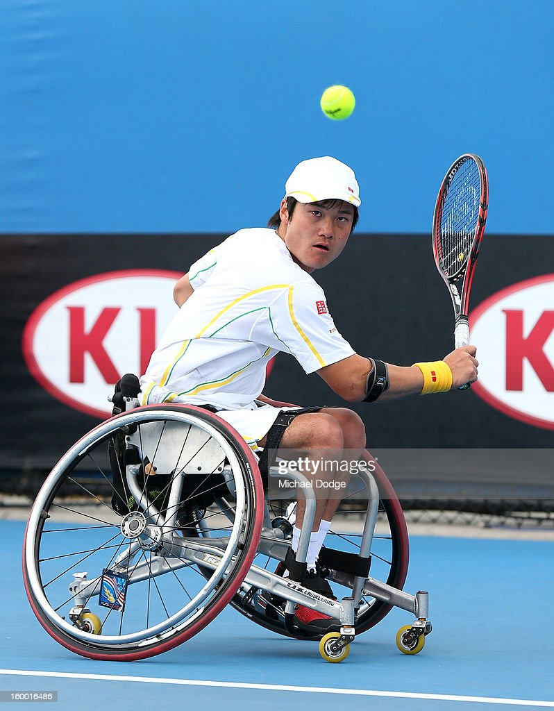 Shingo Kunieda of Japan plays a shot in his Wheelchair Doubles Final with Michael Jeremiasz of France against Adam Kellerman of Australia and Stefan Olsson of Sweden at Melbourne Park on January 25, 2013 in Melbourne, Australia.