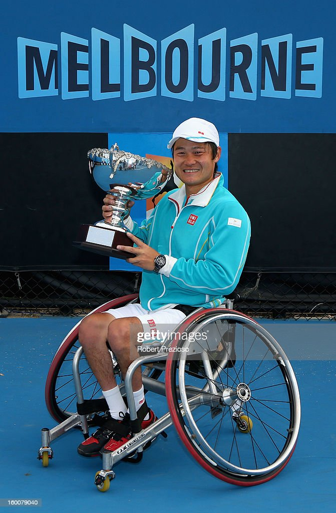 <a gi-track='captionPersonalityLinkClicked' href=/galleries/search?phrase=Shingo+Kunieda&family=editorial&specificpeople=759837 ng-click='$event.stopPropagation()'>Shingo Kunieda</a> of Japan poses with the championship trophy after winning his Men's Wheelchair Singles Final match against Stephane Houdet of France during the 2013 Australian Open Wheelchair Championships at Melbourne Park on January 26, 2013 in Melbourne, Australia.