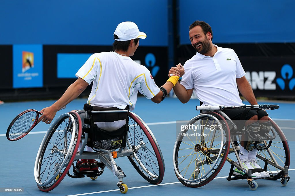 Shingo Kunieda of Japan shakes hands with Michael Jeremiasz of France in their Wheelchair Doubles Final against Adam Kellerman of Australia and Stefan Olsson of Sweden at Melbourne Park on January 25, 2013 in Melbourne, Australia.