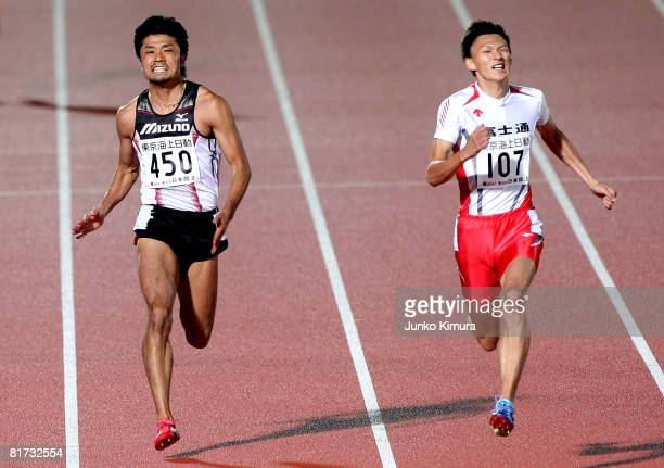 Shingo Suetsugu and Shinji Takahira compete in the Men's 200m Final during the 92nd Japan Track And Field Championship at Todoroki Stadium on June 27...
