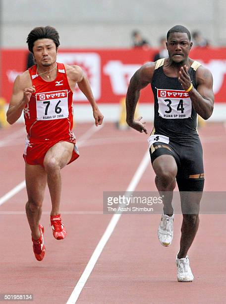Shingo Suetsugu of Japan and Justin Gatlin of the United States compete in the Men's 100m during the IAAF Osaka Grand Prix at Nagai Stadium on May 6...