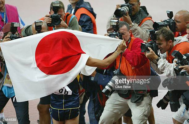 Shingo Suetsugu of Japan celebrates after the men's 200m final at the 9th IAAF World Athletics Championships August 29 2003 at the Stade de France in...