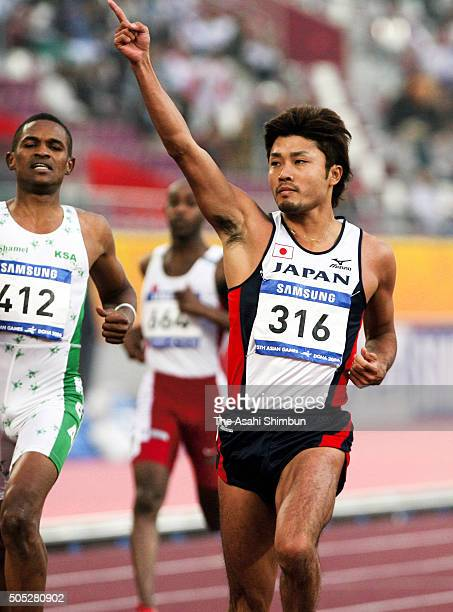 Shingo Suetsugu of Japan celebrates winning the Men's 200m during day ten of the 15th Asian Games at the Khalifa Stadium on December 11 2006 in Doha...