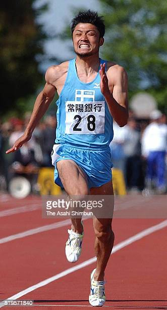 Shingo Suetsugu of Japan competes in the Men's 100m during the Mito International Athletics Championships at the Mito City Stadium on May 6 2002 in...