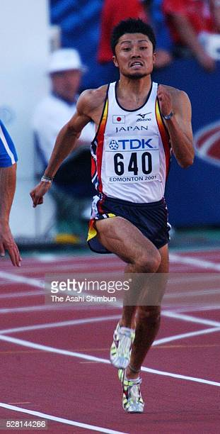 Shingo Suetsugu of Japan competes in the Men's 200m heat during the IAAF World Championships at the Commonwealth Stadium on August 7 2001 in Edmonton...