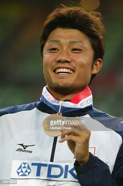 Shingo Suetsugu of Japan holds his bronze medal as he poses for a picture during the men's 200m medal ceremony at the 9th IAAF World Athletics...