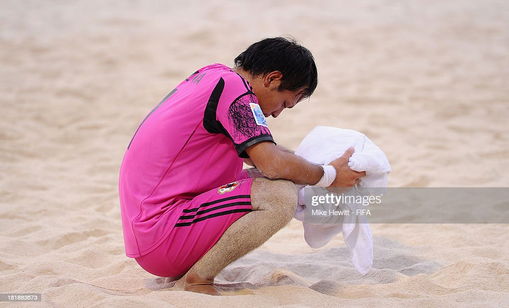 Shingo Terukina of Japan is distraught at the end of the FIFA Beach Soccer World Cup Tahiti 2013 Quarter Final match between Brazil and Japan at the Tahua To'ata Stadium on September 25, 2013 in Papeete, French Polynesia.