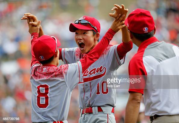 Shingo Tomita and Yuta Komaba of team Japan celebrate after after defeating team Mexico during the International Championship game of the Little...