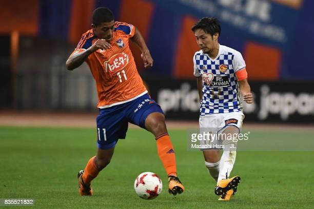 Shingo Tomita of Vegalta Sendai and Douglas Tanque of Albirex Niigata compete for the ball during the JLeague J1 match between Albirex Niigata and...