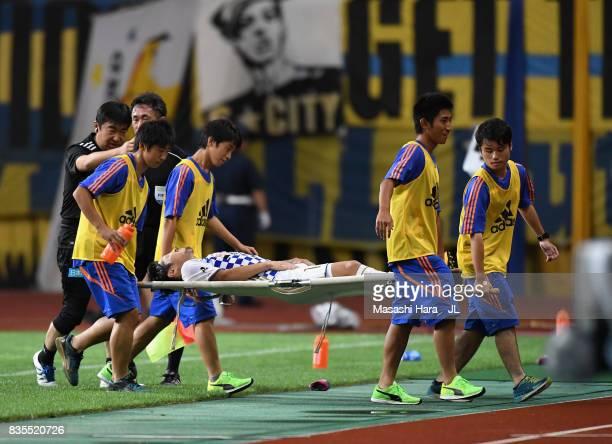 Shingo Tomita of Vegalta Sendai is taken off by a stretcher during the JLeague J1 match between Albirex Niigata and Vegalta Sendai at Denka Big Swan...
