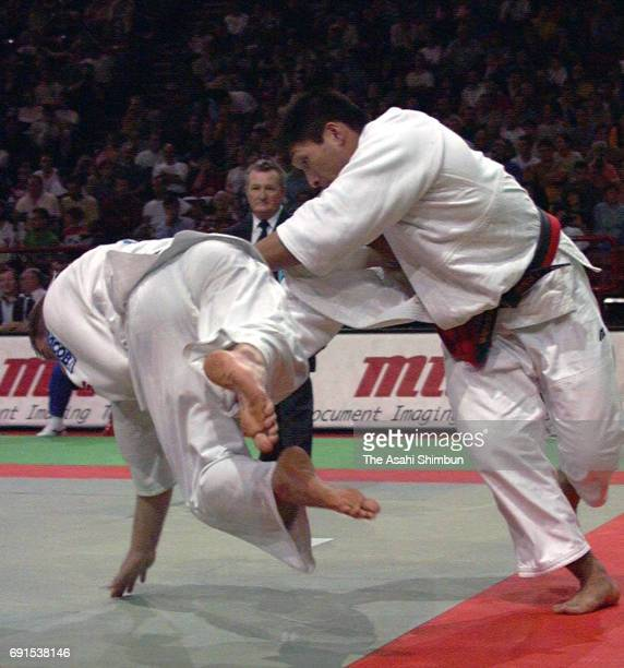 Shinichi Shinohara of Japan and Harry Van Barneveld of Belgium compete in the Men's 95 kg fourth round during the World Judo Championships at Bercy...