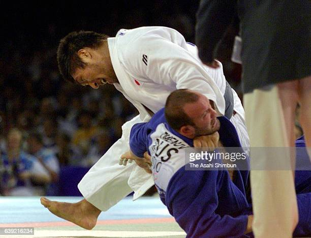 Shinichi Shinohara of Japan and Tamerlan Tmenov of Russia compete in the Men's Judo 100kg semi final during the Sydney Olympics at the Sydney...