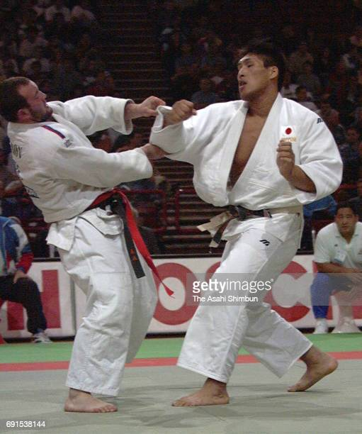 Shinichi Shinohara of Japan and Tamerlan Tmenov of Russia compete in the Men's 95 kg third round during the World Judo Championships at Bercy...