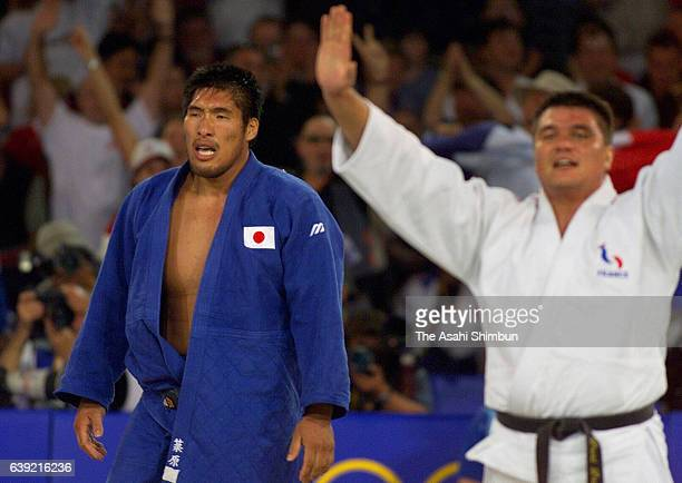 Shinichi Shinohara of Japan reacts after his defeat by David Douillet of France in the Men's Judo 100kg gold medal match during the Sydney Olympics...