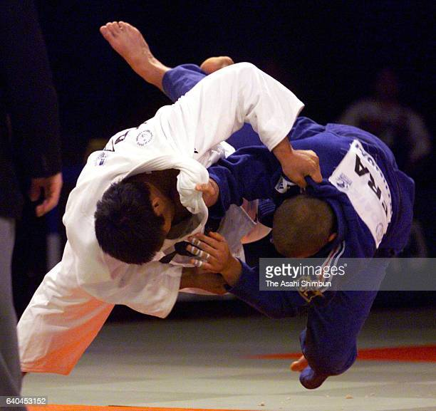 Shinichi Shinohara of Japan throws Jerome Dreyfus of France in the Men's 100kg semi final during the World Judo Championships on October 7 1999 in...
