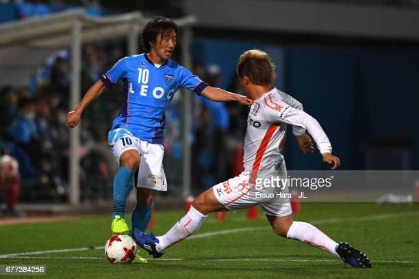 Shinichi Terada of Yokohama FC and Makoto Rindo of Ehime FC compete for the ball during the JLeague J2 match between Yokohama FC and Ehime FC at...