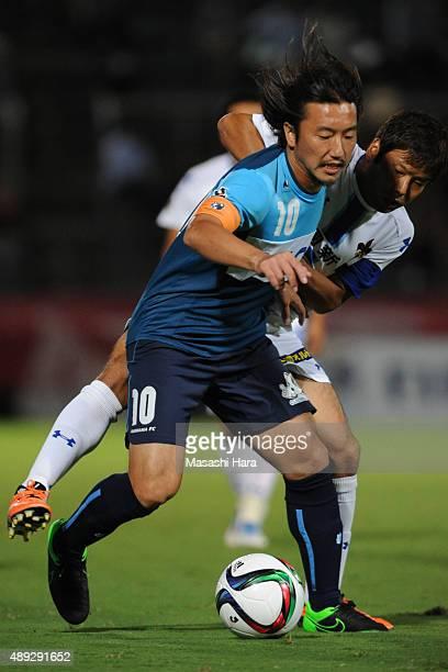 Shinichi Terada of Yokohama FC and Shohei Kiyohara of Zweigen Kanazawa compete for the ball during the JLeague 2nd division match between Yokohama FC...