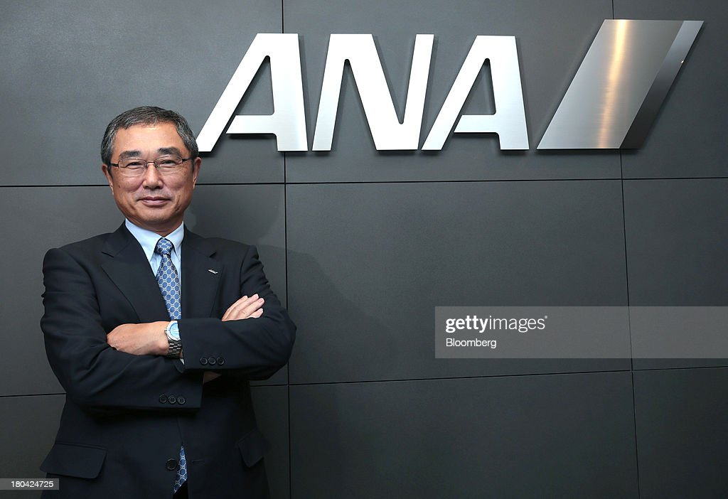 <a gi-track='captionPersonalityLinkClicked' href=/galleries/search?phrase=Shinichiro+Ito&family=editorial&specificpeople=5666038 ng-click='$event.stopPropagation()'>Shinichiro Ito</a>, president and chief executive officer of ANA Holdings Inc. (ANA), poses in front of the company logo following an interview in Tokyo, Japan, on Wednesday, Sept. 4, 2013. ANA Holdings, the Japanese carrier whose fleet is dominated by Boeing Co. aircraft, will decide soon on placing an order for 25 jets, pitting the newest wide-body models of Airbus SAS and Boeing against each other. Photographer: Yuriko Nakao/Bloomberg via Getty Images