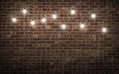 Shining light bulbs on dark brick wall. 3d rendering