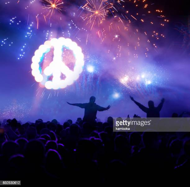 Shining Peace Sign With Firework Display And Celebrating People