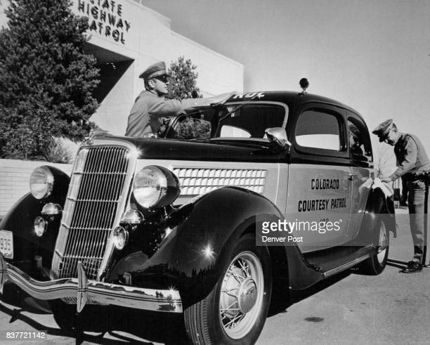 Shining Reminder Of Early Patrol Cars Colorado State Patrol Sgt R L Downey left and Patrolman M E Remington polish a restored 1935 Ford twodoor...