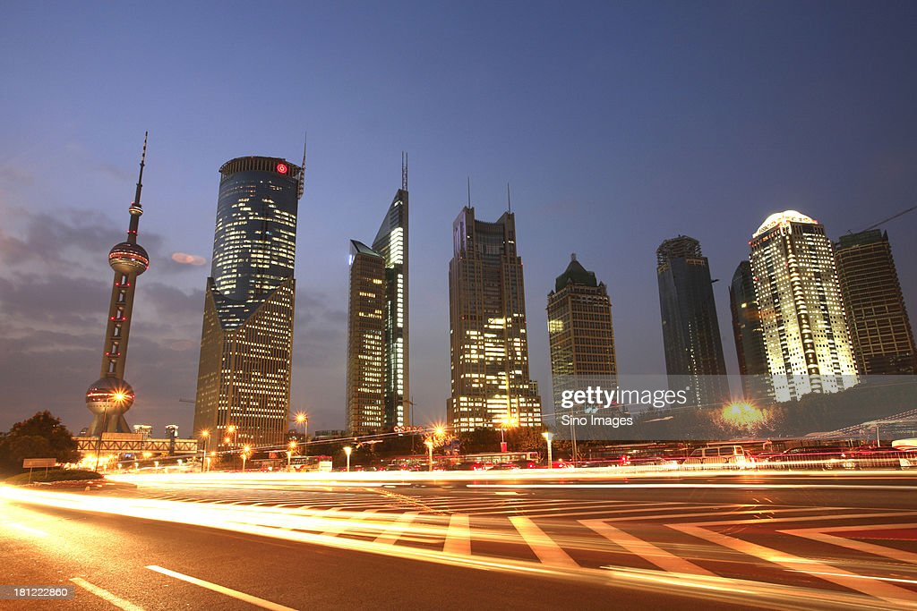 Shining Shanghai towers and highway
