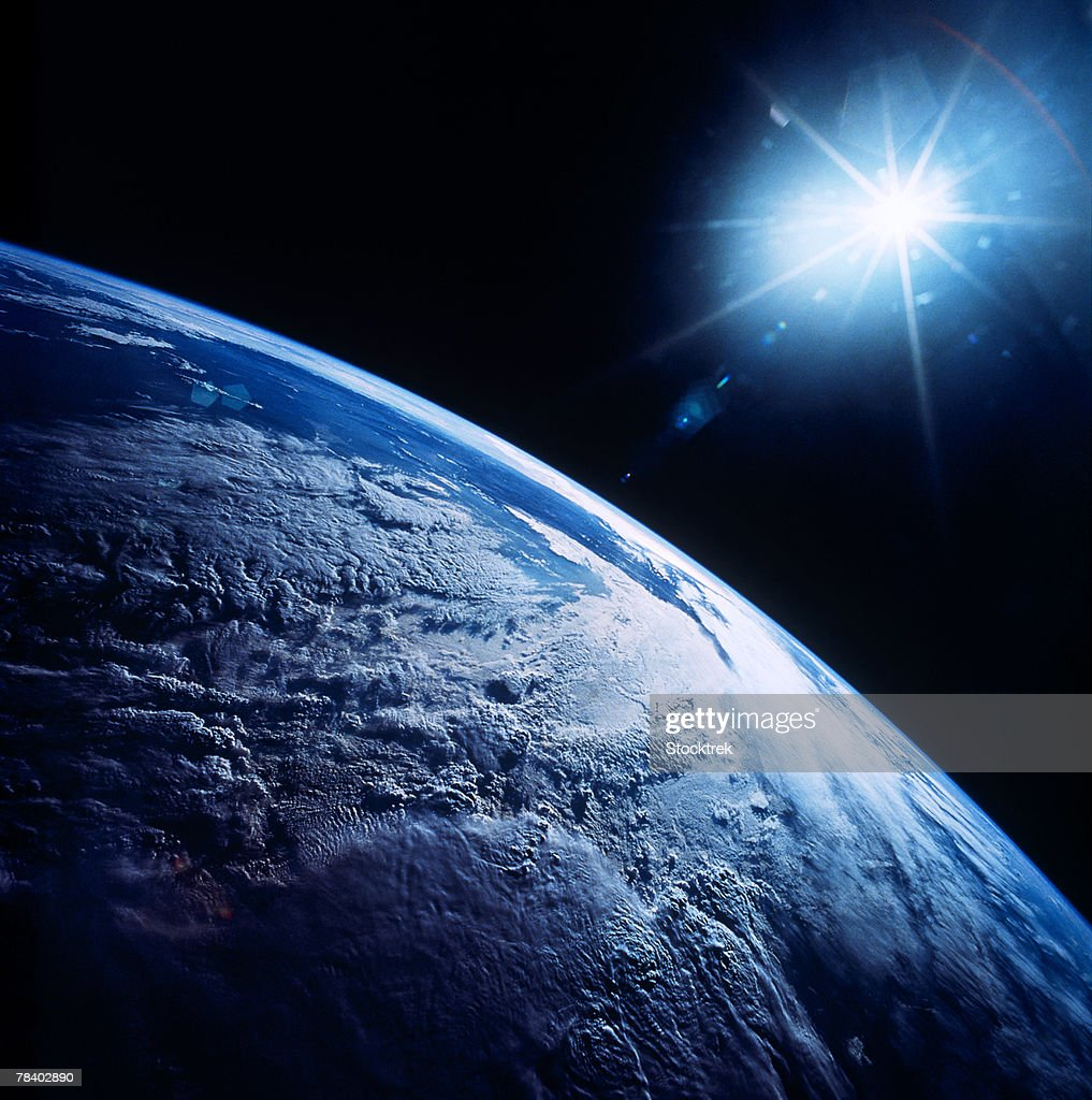 Shining star over earth : Stock Photo