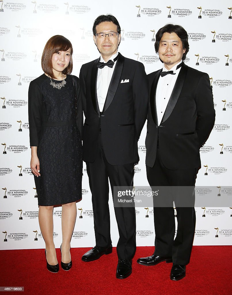 Shinji Aramaki (C) and Kunihiko Mita (R) and guest arrive at the 2014 International 3D and Advanced Imaging Society's Creative Arts Awards held at Steven J. Ross Theatre on January 28, 2014 in Burbank, California.