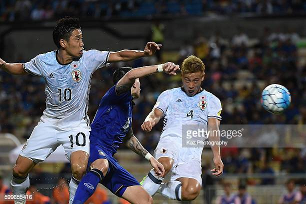 Shinji Kagawa and Keisuke Honda of Japan compete for the ball during the 2018 FIFA World Cup Qualifier between Thailand and Japan at the Rajamangala...