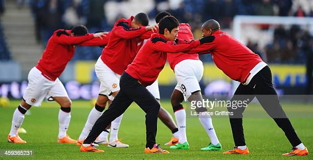 Shinji Kagawa and Ashley Young of Manchester United warm up before the Barclays Premier League match between Hull City and Manchester United at KC...