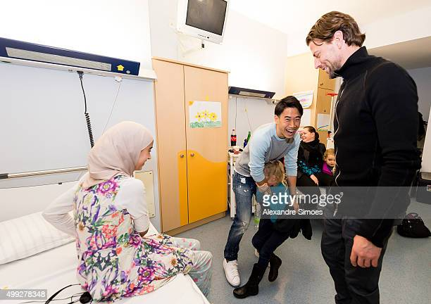 Shinji Kagawa and goalkeeper Roman Weidenfeller is seen during the annual visit of Borussia Dortmund at the children's hospital on November 30 2015...