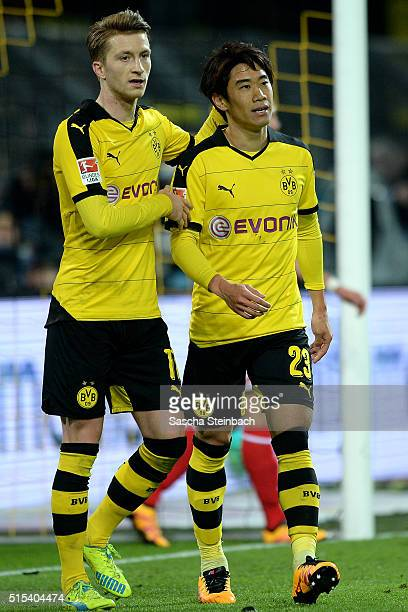 Shinji Kagawa and Marco Reus of Dortmund react after scoring the second goal during the Bundesliga match between Borussia Dortmund and 1 FSV Mainz 05...