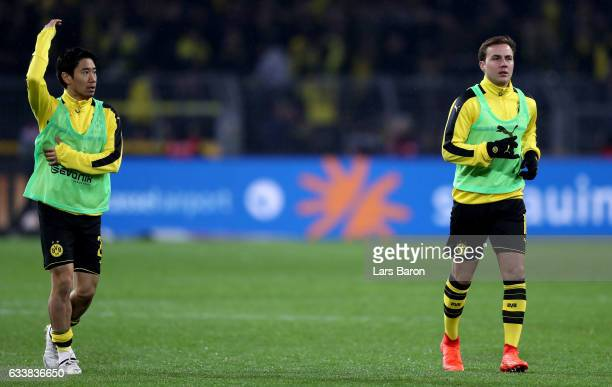 Shinji Kagawa and Mario Goetze of Dortmund are seen after the Bundesliga match between Borussia Dortmund and RB Leipzig at Signal Iduna Park on...