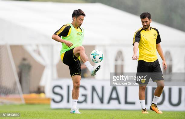 Shinji Kagawa and Nuri Sahin of Borussia Dortmund in action during a training session as part of the training camp on July 31 2017 in Bad Ragaz...