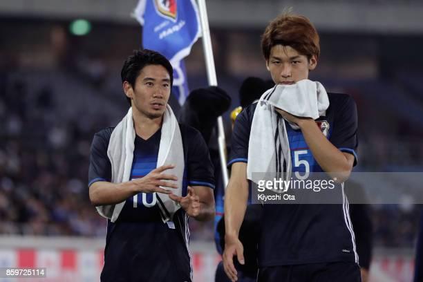Shinji Kagawa and Yuya Osako of Japan talk after their 33 draw in the international friendly match between Japan and Haiti at Nissan Stadium on...