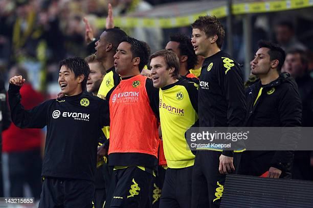 Shinji Kagawa Lucas Barrios Kevin Grosskreutz and Moritz Leitner of Dortmund celebrate winning 21 and the German Championshi after the 1 Bundesliga...