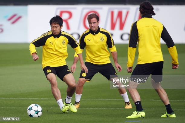 Shinji Kagawa Mario Goetze and Neven Subotic attend a Borussia Dortmund training session ahead of their UEFA Champions League Group H match against...