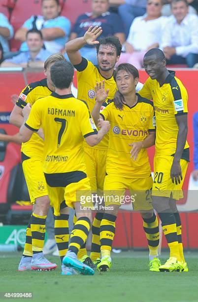 Shinji Kagawa of Borussia Dortmund and his teammates celebrate their team's third goal during the Bundesliga match between FC Ingolstadt and Borussia...