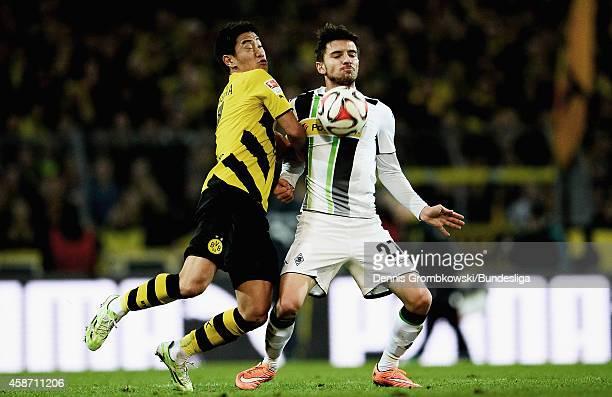 Shinji Kagawa of Borussia Dortmund and Julian Korb of Borussia Moenchengladbach battle for the ball during the Bundesliga match between Borussia...