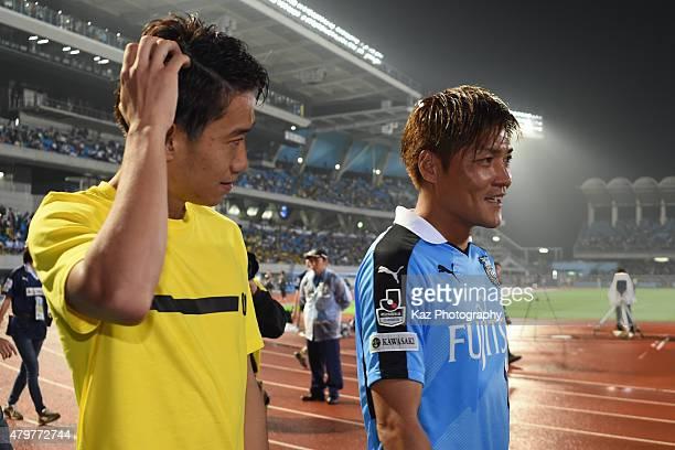 Shinji Kagawa of Borussia Dortmund and Yoshito Okubo of Kawasaki Frontale talk to each other after the game during the preseason friendly match...